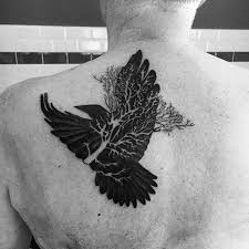 collection of 25 crows flying from tree on back neck