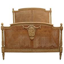 french louis xvi style cane and stripped wood full sized bed for