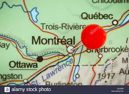 Map Montreal Canada by Close Up Of A Red Pushpin On A Map Of Montreal Canada Stock Photo