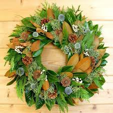 woodsy magnolia wreath includes fresh greens hints of blue