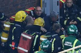 london fire incredible moment man seen waving a jumper from his