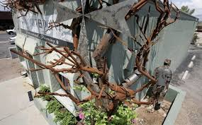 tucson oddity gnarled metal tree takes firm root at piercing