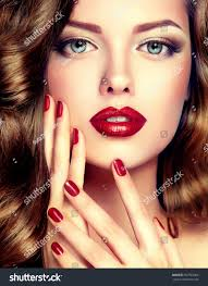 beautiful model curly hair red manicure stock photo 357923366