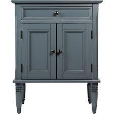 art deco black wooden cupboard with decorative carved swing door