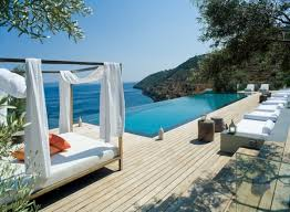 amazing beach side infinity pool designing ideas feats white amazing beach side infinity pool designing ideas feats white outdoor canopy bed plus orange cushions