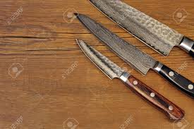 three japanese professonal kitchen knives set on the grunge