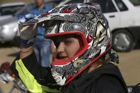 female motocross gear in iran female motocross racer jumps barriers