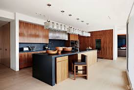 what color countertops with walnut cabinets 25 black countertops to inspire your kitchen renovation