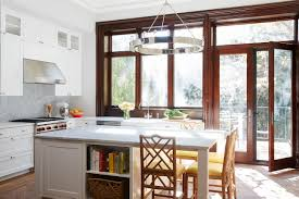 home nicole gibbons studio beautiful brownstone kitchen with faux bamboo stools