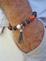 mens charm bracelet images Men 39 s bracelet with terracotta jasper and hand carved skull jpg