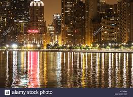 chicago skyline at night featuring the drake hotel along lake