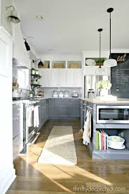 10 fab farmhouse kitchen makeovers where they painted the budget painted farmhouse kitchen makeover via miss mustard seed