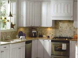 interior stylish white kitchen cabinet design with silver stove