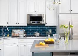 white kitchen cabinets with blue subway tile blue subway tiles with white cabinets transitional
