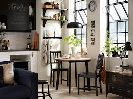 dining room furniture ideas ikea black and white kitchen with small round table and two chairs in the corner