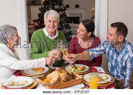 family at traditional dinner table or julbord in sweden