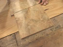 Wood Floors In Bathroom by How To Install Snap Together Tile Flooring How Tos Diy