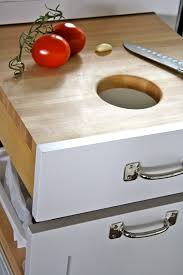cool cutting boards so clever a cutting board you can pull out with the garbage right
