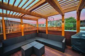 second story deck with pergola lattice wall and custom patio