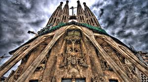 religious gaudi sagrada familia church barcelona spires clouds