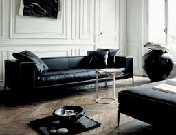 choosing black leather sofas for striking living room feature