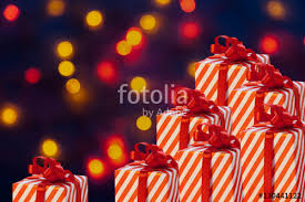 New Years Decorations Sale by Christmas Gifts With Red Ribbon On A Dark Blue Background With Red