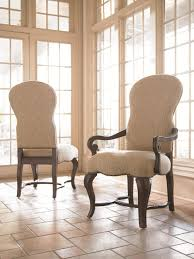 high back upholstered dining room chair with wooden arms on