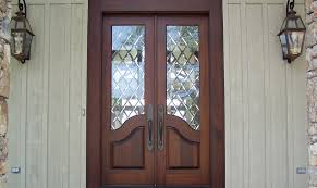 french country double entry doors give charming completions to the