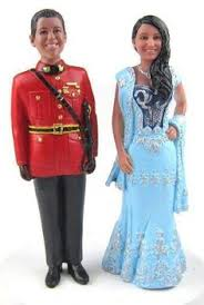 charming couple cake topper sculpted to look like the bride and