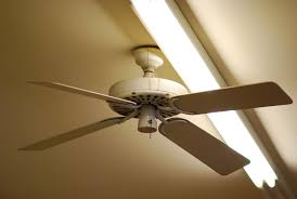 industrial looking ceiling fans with bookcase battey spunch decor