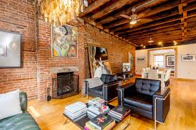 a 32 foot long living room with exposed brick dominates this