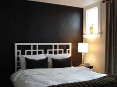 Bedroom Accent Wall With Snazzy Penny Tiles Decoist by Bedroom Retreat Roundup A Gallery Of Art Above The Bed Black