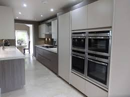 a two tone siematic kitchen in the uk combines white and titan