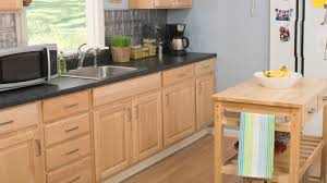 how to reface kitchen cabinets video hgtv