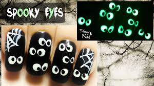 easy halloween spooky eyes glow in the dark freehand nail art