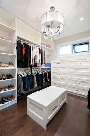 walk in closet with storage bench with drawers transitional closet