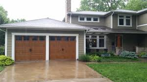 clopay gallery collection steel garage doors with faux wood ultra
