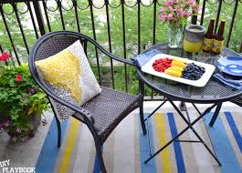 how to paint an outdoor rug in three easy steps for your patio space
