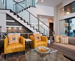 modern home living room with central stairs feat glass banisters