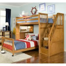 light brown wooden bunk bed with drawers on the stairs combined with desk also red white plus blue stripped bedding set