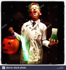 boy dressed in mad scientist costume on halloween stock photo