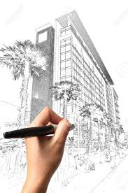 male hand drawing building and cityscape as architect plan stock