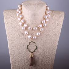 earrings and things pendant drop earrings and pearl brown tassel necklace set