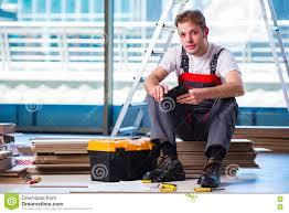 Laminate Flooring Construction The Man Laying Laminate Flooring In Construction Concept Stock