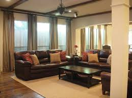 Bedrooms With Black Furniture Design Ideas by Brown Leather Sofa With Red And Cream Cushions Also Black Wooden