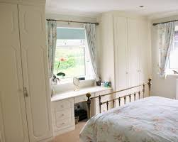 fitted wardrobes with classic styles panels and dressing table