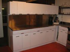 Robert And Carolines Mid Century Home With Dreamy St Charles - Metal kitchen cabinets