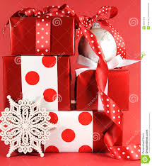 stack of and white polka dot theme festive gift box presents