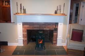 custom harwood cherry mantel and custom fireplace surround on central colonial red brick chimney
