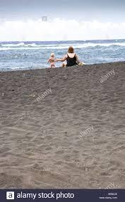 mother an toddler on punalu u0027u black sand beach hawaii big